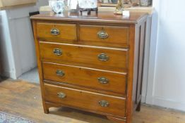 An Edwardian stained beech chest, with two short and three long drawers, on bracket feet. 102cm by