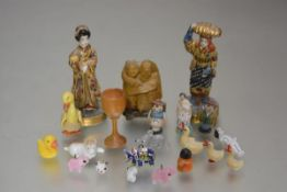 A collection of miniature figures including two Japanese porcelain figures, two resin Japanese style