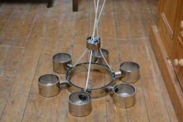 A 1970's stainless steel finish circular pendant light fitting with six circular light pods with