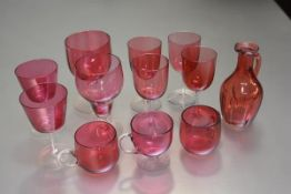 A set of four Edwardian cranberry glass wine glasses, two large goblets, a pair of 1950s cocktail