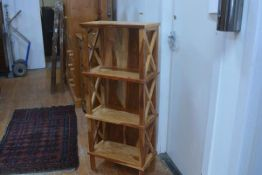 A hardwood upright three tier etagere, shelves with fluted edge and x-framed side supports. 120cm by
