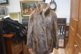 A Jenners lady's ranch mink fur jacket with belt, with satinised lining and slash pockets to side (