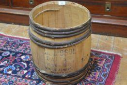 A Spanish pine and oak bound barrel stamped Import, Contents Details (h.39cm x d.34cm)