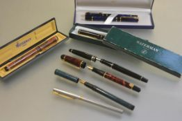 A collection of late 20thc Waterman fountain pens, a Laureat blue marble (boxed) pen and