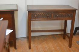 A Bevan Funnell reproduction oak side table, with rectangular top over arcaded drawers, on square