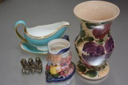 A Wedgwood sauceboat with speckled turquoise blue and gilt reserves, a Wade pottery vase (h.23cm), a