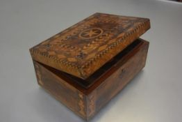 A 19thc walnut parquetry inlaid sewing box, the rectangular top with star shaped inlay, enclosed