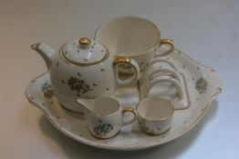 A Gray's Pottery breakfast cabaret set including cup, fitted saucer, toastrack, milk jug, sugar