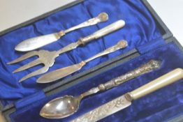 An Epns handled jam spoon, an Epns butter knife, a pair of butter knives, a mother of pearl