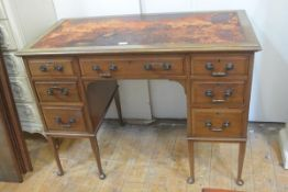 An Edwardian mahogany writing desk, the rectangular top with inset skiver (a/f), above a centre