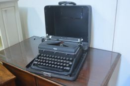 A Royal Quiet Deluxe portable typewriter with original case