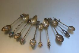 Ten various silver and white metal souvenir teaspoons including Canada, Keswick, etc.