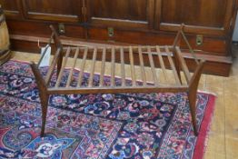 A 1970s teak luggage rack with tapered shaped uprights and brass tube supports (h.43cm x 72cm x