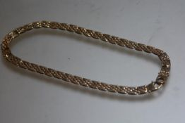 A 9ct gold fancy gatelink style necklace (l.17cm) (34.54g)