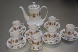 A Paragon china Flamenco pattern coffee service of fifteen pieces, with stylised enamel design, with