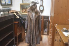 A lady's ranch mink full length jacket (l.113cm) and three various mink hats including a winter