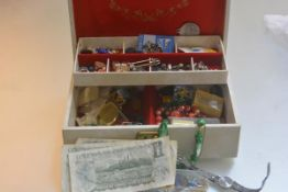 A jewellery box containing three Canadian one dollar notes, miscellaneous costume jewellery