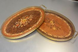 A pair of Sorrento ware inlaid oval brass gallery and twin handled trays (each: h.3cm x 47cm x