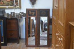 A pair of modern painted wood rectangular panelled mirrors with decorative floral enamelled and