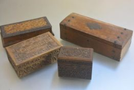 Two Bavarian style carved treen boxes, one with fitted interior, a pokerwork rectangular card box,