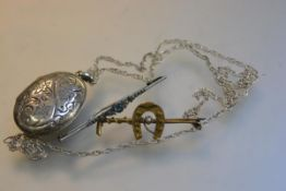A yellow metal bar brooch in the form of a whip with horse's shoe mounted with seed pearl, stamped