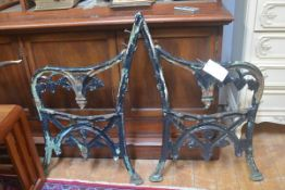 A pair of late 19thc/early 20thc cast wrought iron garden bench ends of vine, fruit and leaf design,