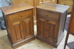 A pair of hardwood bedside cabinets, with rectangular tops over single frieze drawers, over