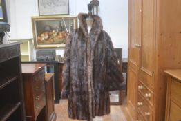 A 1920s/30s lady's three quarter length musquash jacket/coat retailed by McEwans of Perth, (chest: