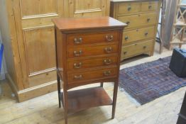 An Edwardian mahogany satinwood and ebony strung sheet music chest, with four fall-front drawers and