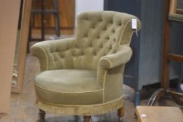 A Victorian walnut framed button back tub chair with upholstered back, arms and seat, in green