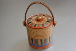 A Japanese porcelain Thousand Face pattern biscuit barrel with bamboo swing handle to top (h.13cm)
