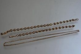 A Victorian yellow metal two part guard chain (a/f) (23cm and 18cm) and a 9ct gold belcher link