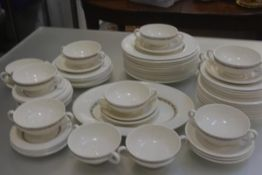 A Wedgwood Edme Ceres china dinner service with brown transfer printed laurel wreath border,