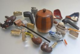 A collection of pipesmoking related items including a tobacco jar, a collection of treen carved