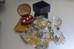 An Edinburgh Crystal paperweight, miscellaneous costume jewellery, brooches, two silver rings