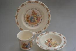A Royal Doulton Bunnykins three piece child's Christening set including mug, bowl and plate, with
