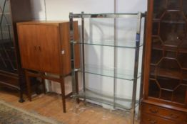 A 1970s/80s chromium plated four tier upright open display stand (h.140cm x 93cm x 32cm)