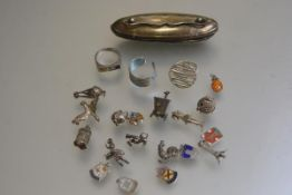 A Birmingham silver mounted nail buffer, a white metal gem set ring, a titanium ring, a white