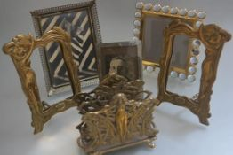 An Art Nouveau style brass two division letter rack of female form design, a pair of brass Art