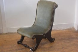 A 19thc ebonised brass mounted child's scroll back chair, upholstered in draylon, raised on scroll