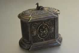 A Victorian Epns dome top hinged biscuit barrel with seated hound and chased cherub and Bacchus mask