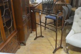 An Edwardian stained four bar towel rail raised on twin end turned supports (h.83cm x 76cm x 28cm)