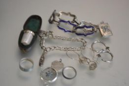 A silver thimble with original case, a white metal blue enamelled bracelet, a silver charm