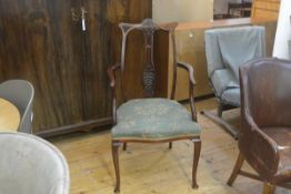 An Edwardian mahogany open armchair with pierced carved splat back, with stuffover seat in woven