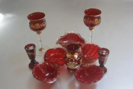 A collection of ruby Murano glass including two white wine glasses with gilded and floral