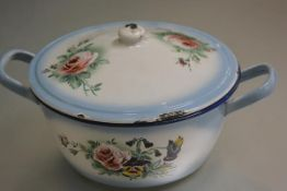 A Continental white enamelled and blue bordered two handled dish and cover with enamelled rose and