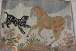 A North Indian crewelwork panel depicting a horse and hound complete with pine pole, backed (62cm