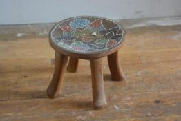 A Nigerian hardwood carved stool with inset beaded top (h.18cm x 21cm)