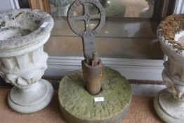 A carved sandstone turning wheel complete with cast iron pillar and clutch for soft ground key (