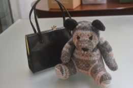 A lady's Eros black leather twin handled handbag (18cm x 26cm) and a Shetland machine knitted